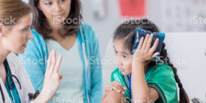 child holding ice pack